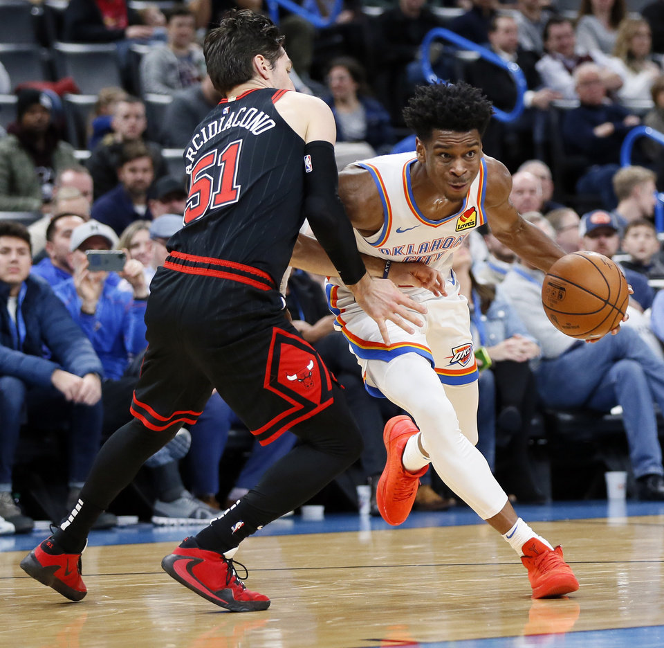Photo - Oklahoma City's Shai Gilgeous-Alexander (2) drives against Chicago's Ryan Arcidiacono (51) in the second quarter  during an NBA basketball game between the Oklahoma City Thunder and Chicago Bulls at Chesapeake Energy Arena in Oklahoma City, Monday, Dec. 16, 2019. [Nate Billings/The Oklahoman]