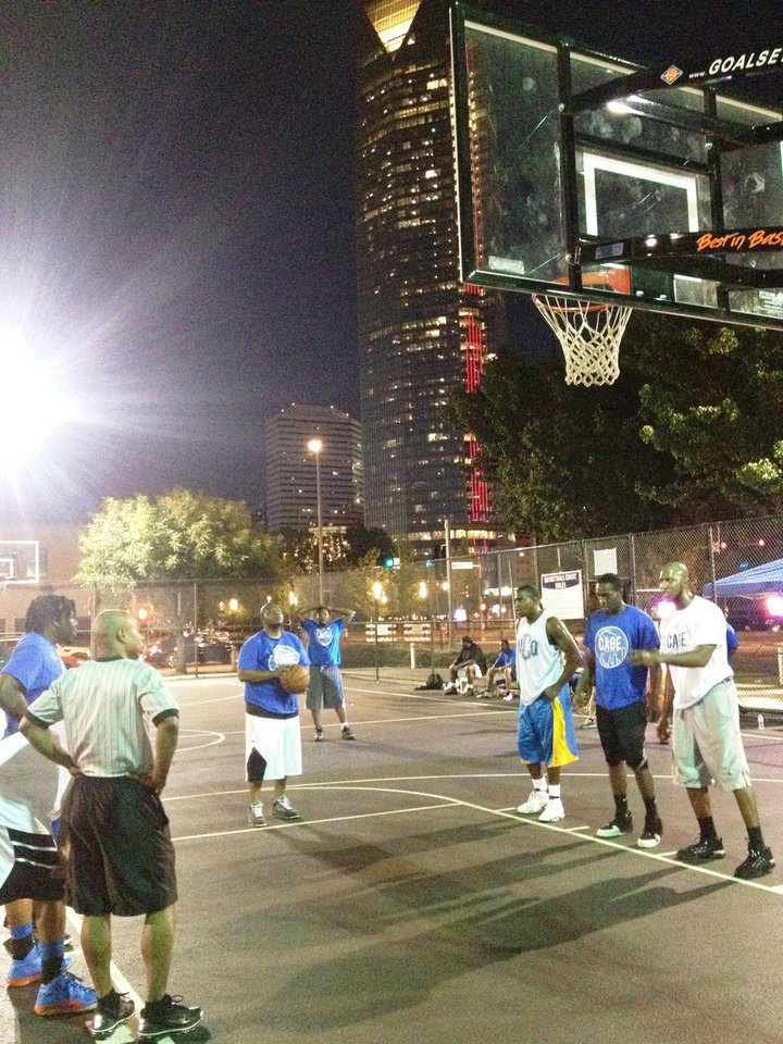 Photo - The Cage tournaments are drawing basketball fans downtown every Sunday night.  Provided