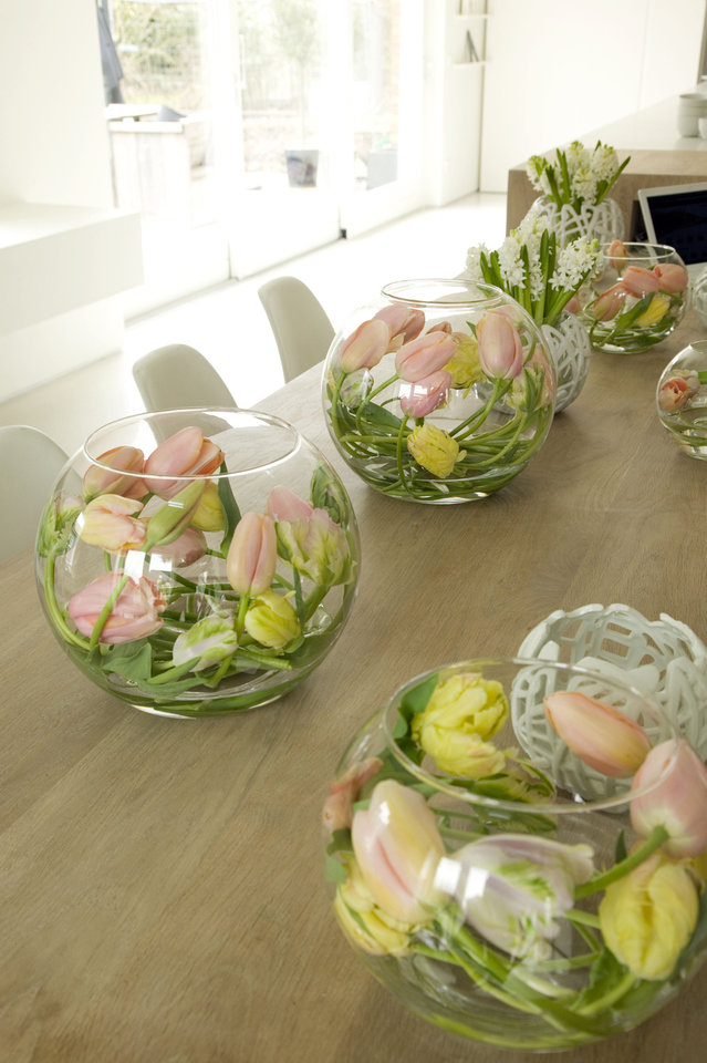 Photo - Pastel tulips are bunched in a glass bowl for an unusual centerpiece idea. Photo provided by iBulb.  Jeannine Govaers
