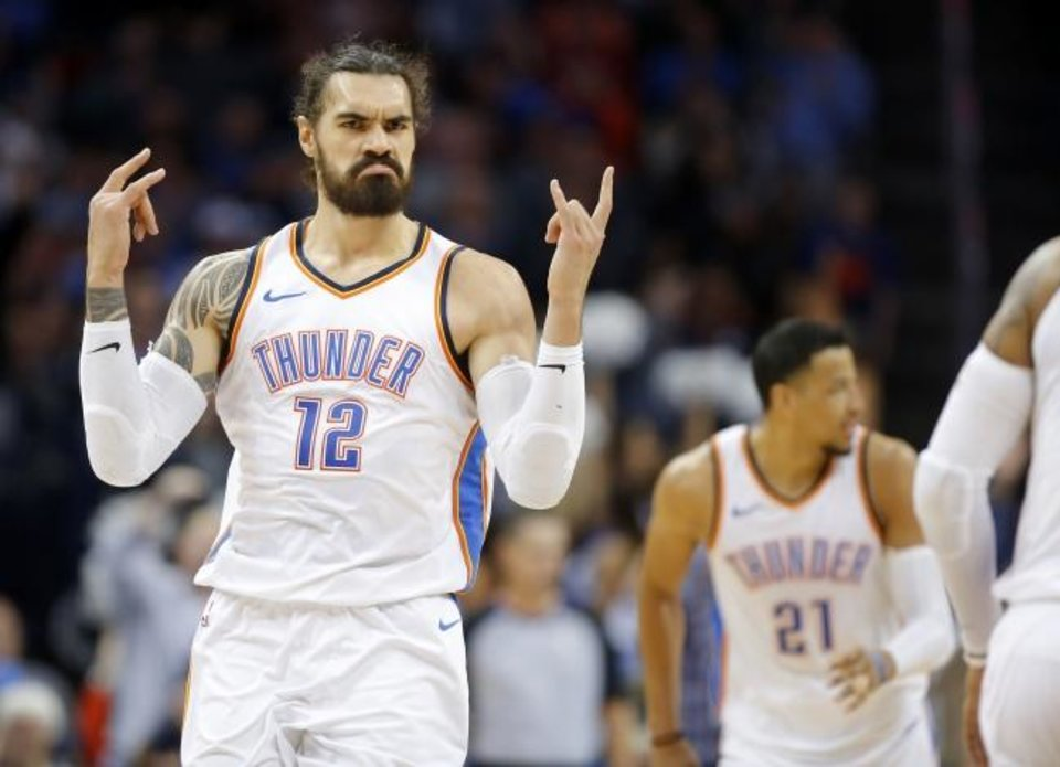 Photo -  Oklahoma City's Steven Adams (12) celebrates after a dunk during a 2017 game against the Raptors at Chesapeake Energy Arena. [Bryan Terry/The Oklahoman]