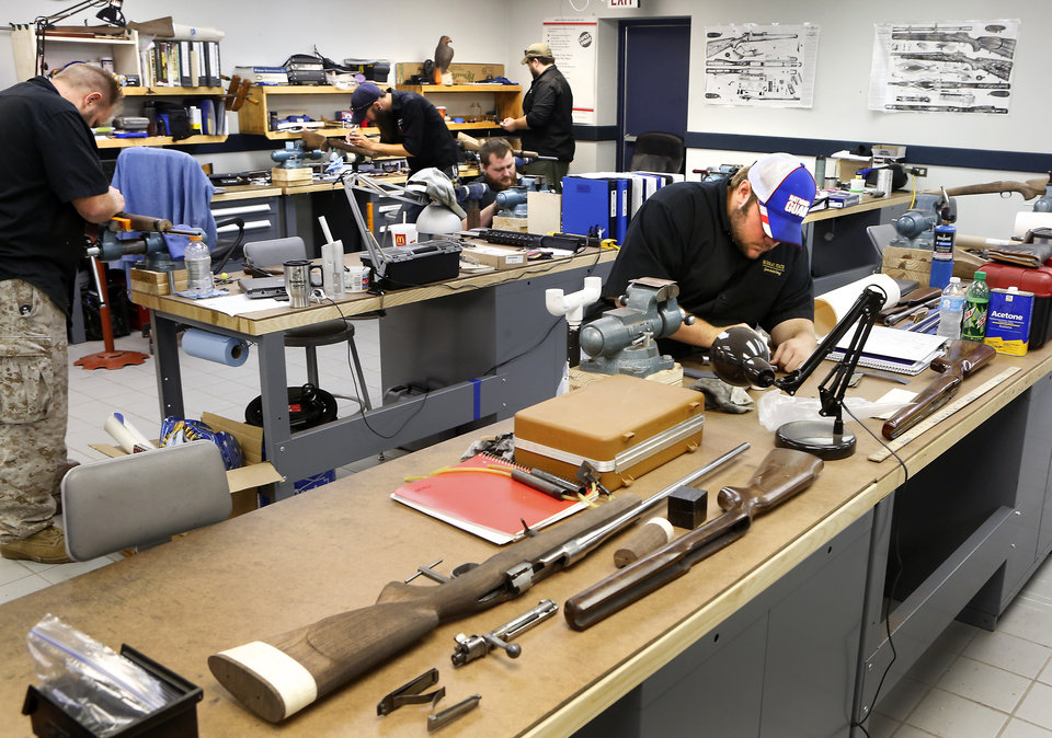 Photo -  Students work on guns at Murray State College on October 1.    David McDaniel -  The Oklahoman