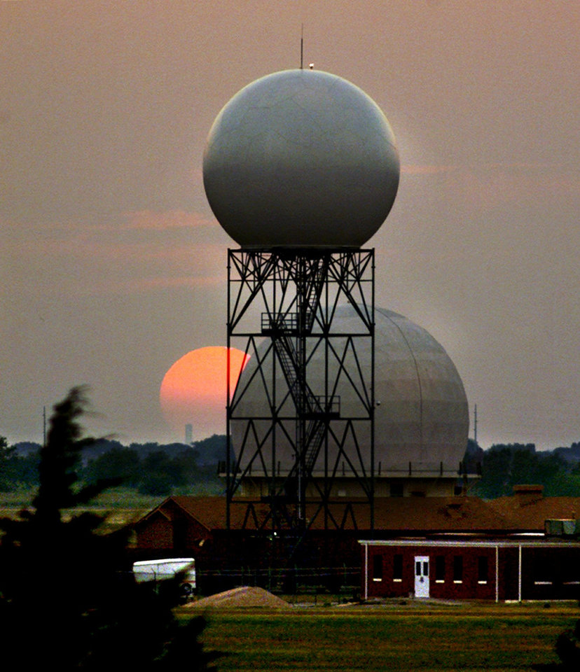 Photo - Sunset over the National Severe Storms lab radar domes in Norman.  Staff photo by Steve Sisney