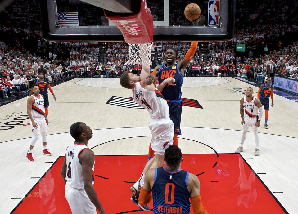Photo - Oklahoma City Thunder forward Nerlens Noel, center right, shoots over Portland Trail Blazers forward Meyers Leonard during the first half of Game 5 of an NBA basketball first-round playoff series, Tuesday, April 23, 2019, in Portland, Ore. (AP Photo/Craig Mitchelldyer)