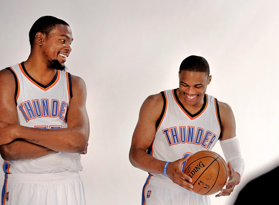 Photo - Teammates Kevin Durant, left, and Russell Westbrook tease each other during a photo session together at OKC Thunder Media Day in  Chesapeake Arena on Monday, Sep. 29, 2014.  Photo by Jim Beckel, The Oklahoman