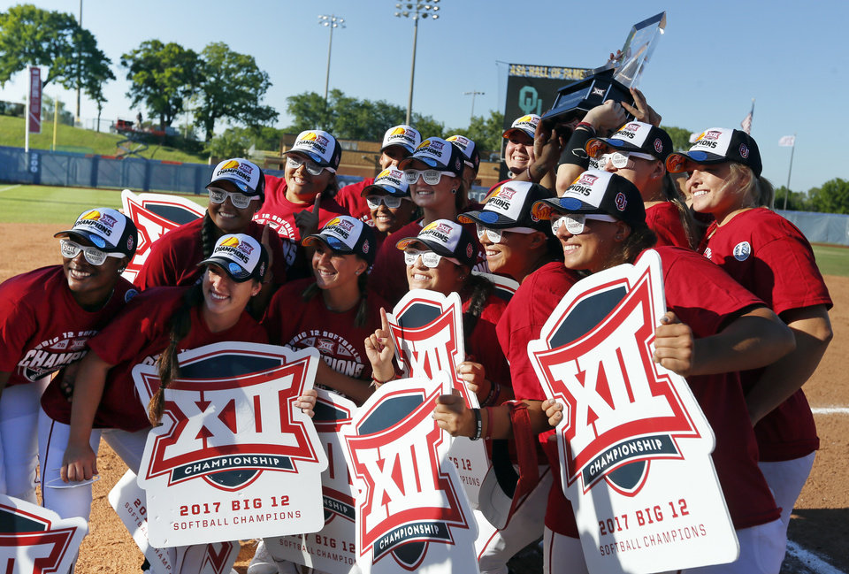 Photo - The Sooners pose for a photo after the championship game of the Big 12 softball tournament between Oklahoma and Oklahoma State (OSU) at ASA Hall of Fame Stadium in Oklahoma City, Saturday, May 13, 2017. OU won 2-0. Photo by Nate Billings, The Oklahoman