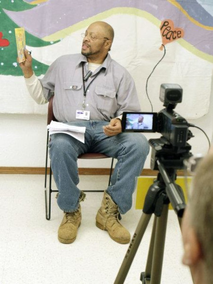 Photo - Gregory Fagan, at Clara Waters Community Correctional Center, is recorded as he reads to his family.  PHOTO BY PAUL HELLSTERN, THE OKLAHOMAN