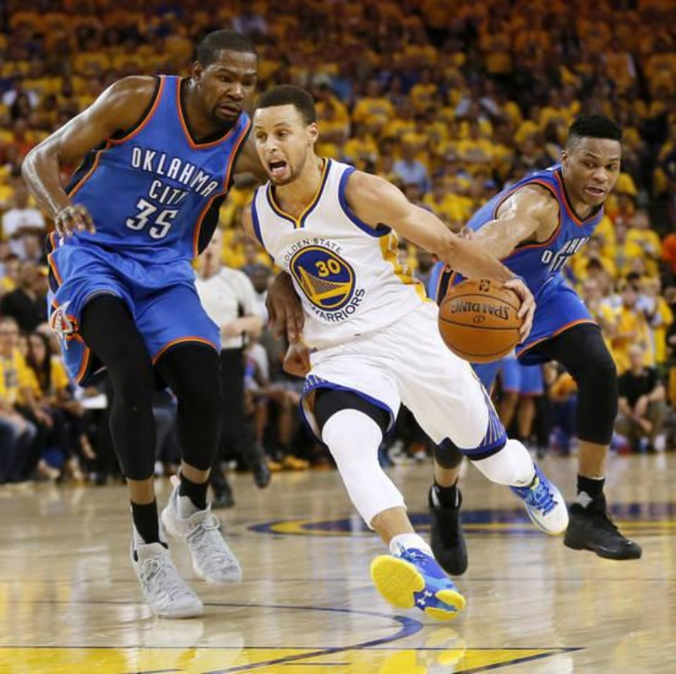 Photo - Kevin Durant guards Steph Curry in Game 7 of the Western Conference finals. (Photo by Nate Billings)