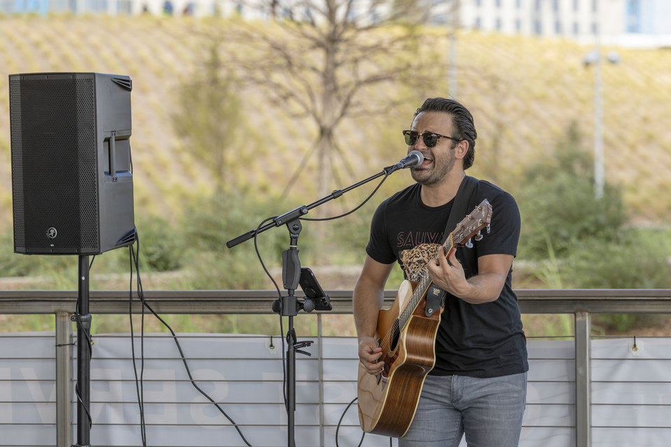 Photo - Josh Roberts performs at the Boathouse during the grand opening weekend of Scissortail Park in Oklahoma City, Sunday, Sept. 29, 2019. (Alonzo Adams for The Oklahoman)