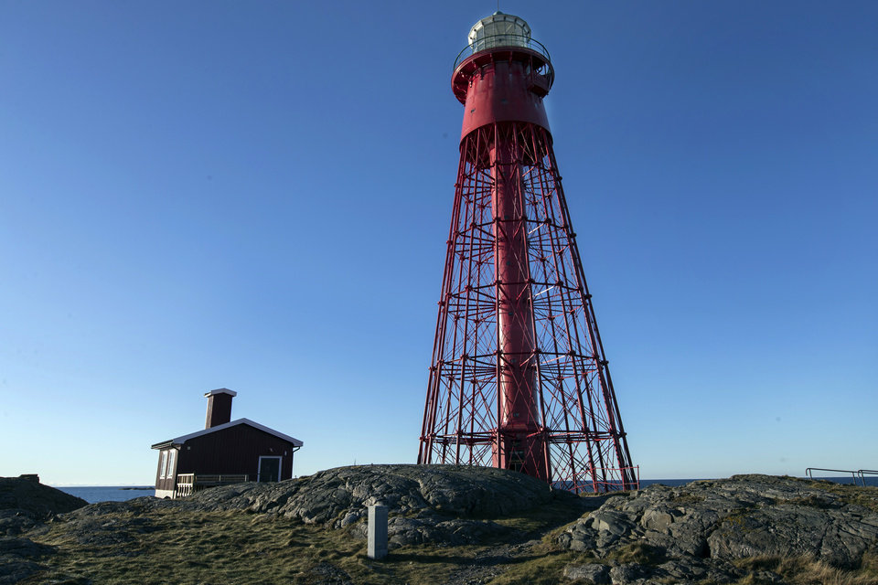"Photo -  The lighthouse and cabin, which will act as a screening rooms, on the island of Hamneskar, western Sweden on Saturday, Jan. 30, 2021. The 44th Goteborg film festival opened this weekend in a mostly virtual format but an emergency ward nurse from Sweden was selected among 12,000 volunteers to spend a week on an isolated island in the North Sea with for only companionship the events' entire movie selection. Lisa Enroth said the opportunity gave her ""time to reflect"" after a busy year amid the COVID pandemic. (AP Photo/Thomas Johansson)"