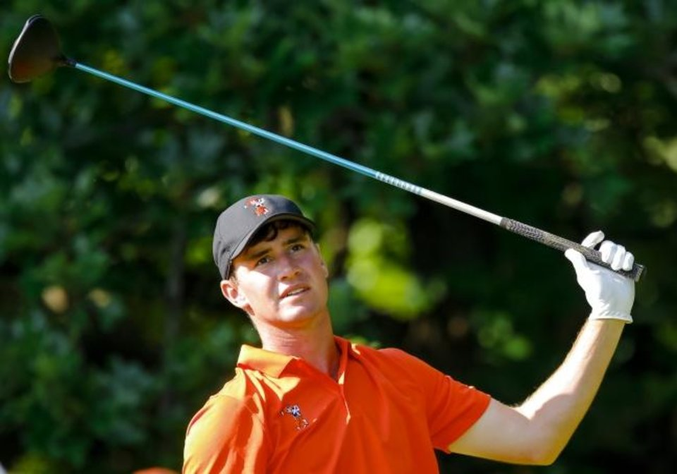 Photo -  Oklahoma State's Austin Eckroat reacts to his tee shot during match play in the NCAA Mens 2018 Golf Championships at Karsten Creek Golf Club in Stillwater. Eckroat of Edmond is playing as an amateur in the U.S. Open which begins Thursday in Pebble Beach, California. [Chris Landsberger/The Oklahoman]