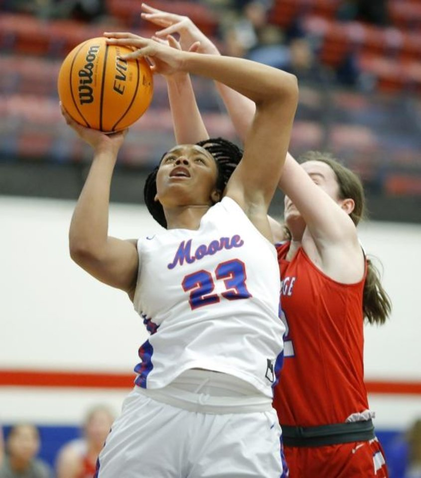 Photo -  Moore's Aaliyah Moore is fouled by Bishop Miege's Payton Verhulst during a girls basketball game on Friday. [Bryan Terry/The Oklahoman]