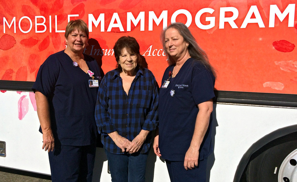 Photo -  From left are LaDean Smith, a mammogram technician, Rocky Avery, a Holdenville resident and patient, and Brenda Jacques, who drives one of OU Medicine's mobile mammogram RVs. The mobile unit stopped in Holdenville on Nov. 29 to perform breast cancer screenings for women who can't easily make the 50-mile drive to Shawnee, the nearest city where they could get mammograms. The goal is to catch cancers early, when they are easier to treat. [Photo by Meg Wingerter, The Oklahoman]