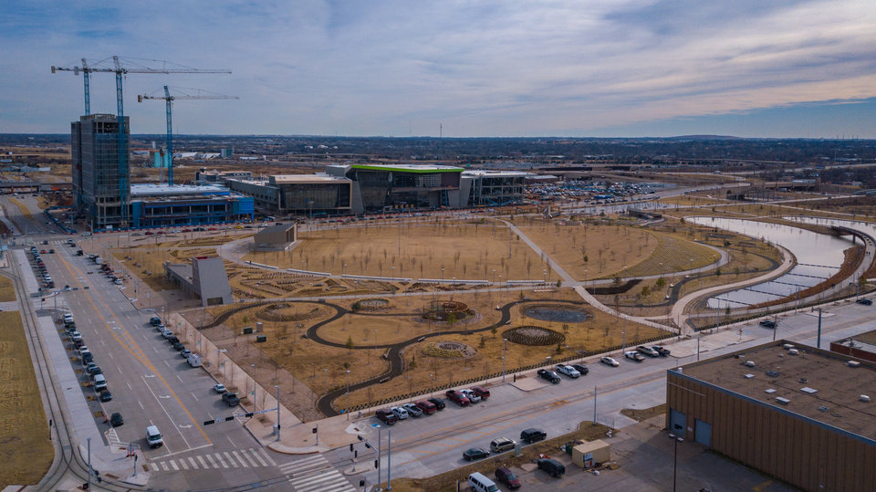 Photo - Drone image of Scissortail Park, with construction of the Omni Hotel and convention center in the background. Image by Dave Morris.