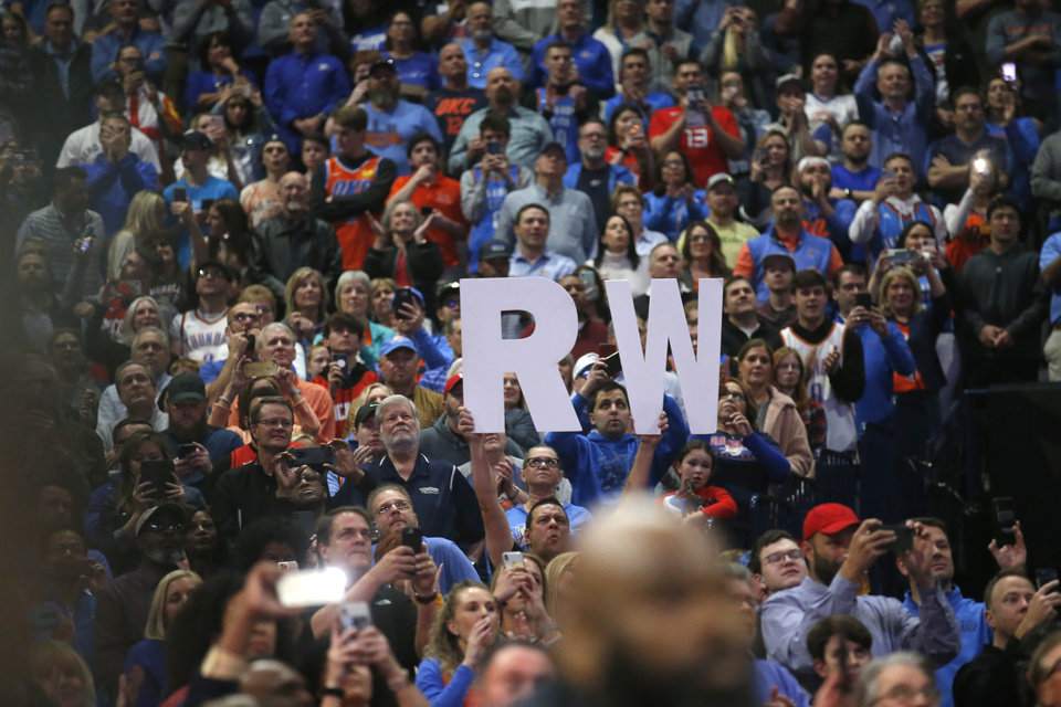 Photo - Fans hold up a sign for Houston's Russell Westbrook (0) before the NBA basketball game between the Oklahoma City Thunder and the Houston Rockets at the Chesapeake Energy Arena in Oklahoma City,  Thursday, Jan. 9, 2020.  [Sarah Phipps/The Oklahoman]