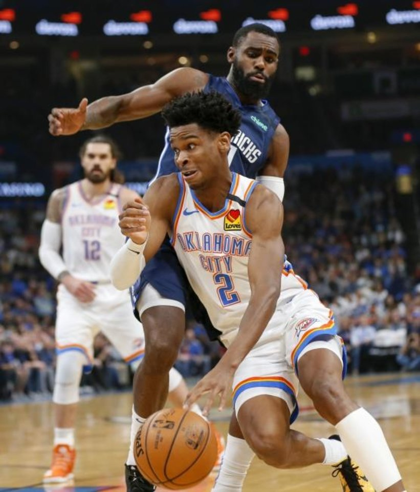 Photo -  Oklahoma City's Shai Gilgeous-Alexander (2) drives past Tim Hardaway Jr. during Monday's game against Dallas at Chesapeake Energy Arena. [Nate Billings/The Oklahoman]