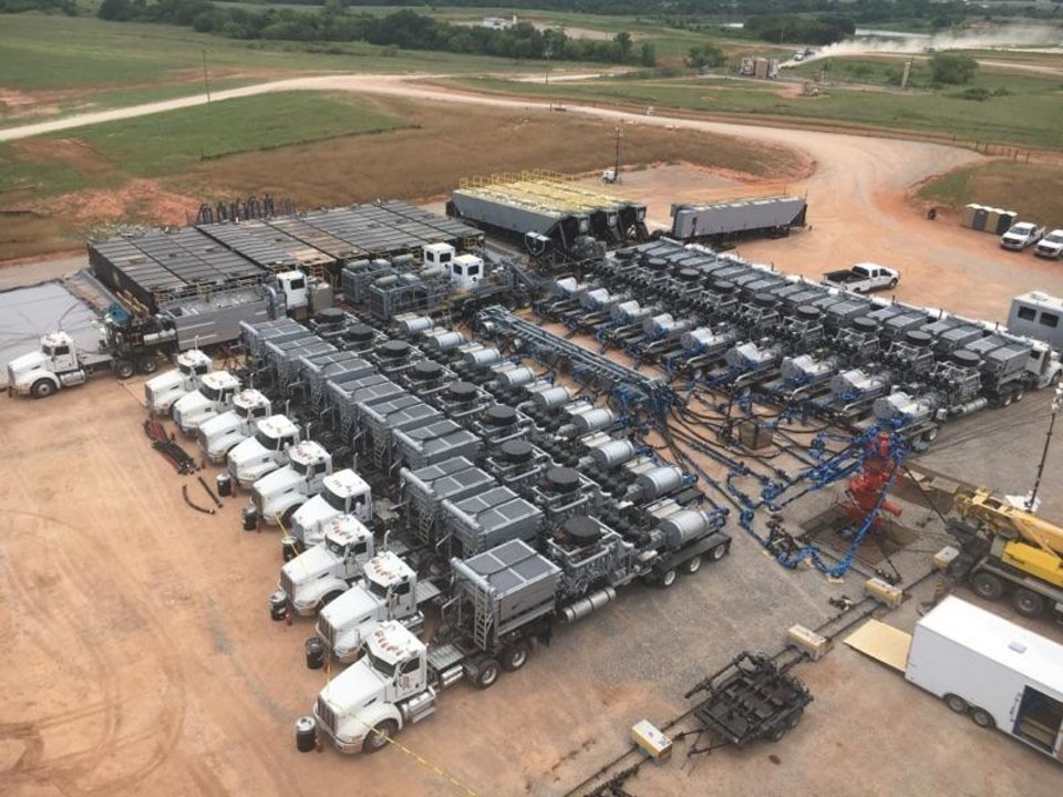 Photo -  This aerial photograph shows a collection of equipment that makes up a well completion spread for Stingray Pressure Pumping.