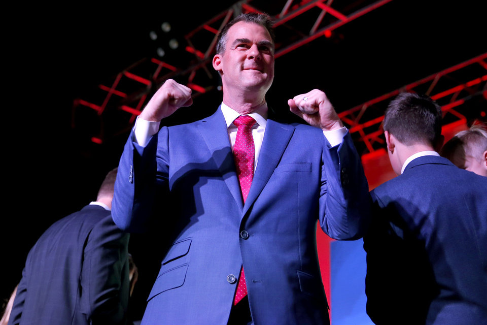 Photo - Kevin Stitt gestures after giving his acceptance speech during the Republican election night watch party for the 2018 elections at the Bricktown Events Center in Oklahoma City, Nov. 6, 2018. Photo by Bryan Terry, The Oklahoman