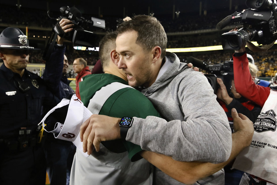 Photo -  Baylor coach Matt Rhule, left, and Oklahoma coach Lincoln Riley hug after the Sooners survived for a 34-31 win Saturday. [AP Photo/Ray Carlin]