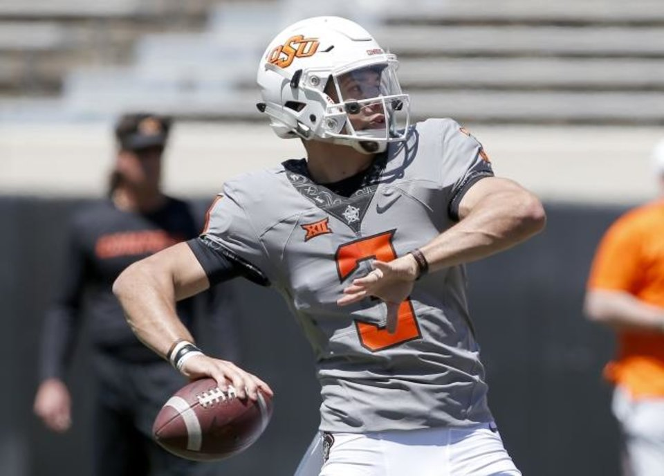 Photo -  Oklahoma State's Spencer Sanders (3) looks to throw the ball during drills during the Oklahoma State Cowboys spring practice at Boone Pickens Stadium in Stillwater, Okla., Saturday, April 20, 2019.  Photo by Sarah Phipps, The Oklahoman