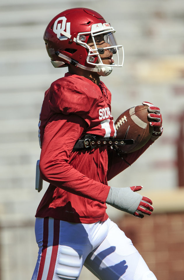 Photo - Receiver Theo Wease (10) runs with the ball during the University of Oklahoma spring football practice at the Gaylord Family Oklahoma Memorial Stadium in Norman, Okla. on Monday, April 1, 2019.  Photo by Chris Landsberger, The Oklahoman