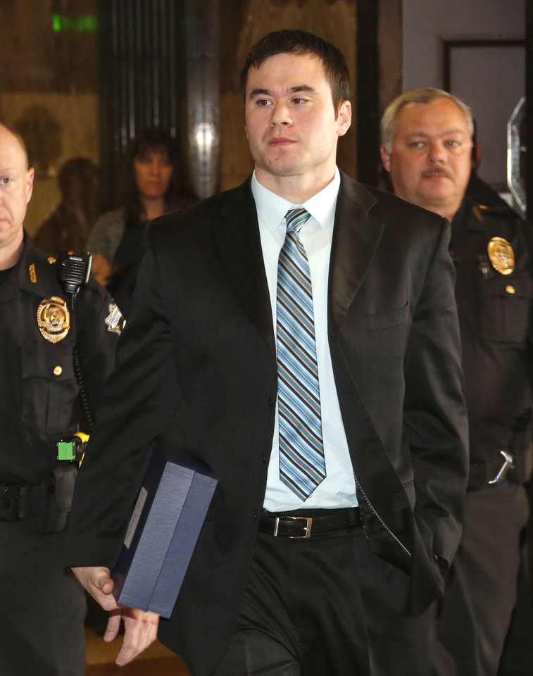 Photo - Daniel Holtzclaw leaves Judge Henderson's courtroom for lunch break at the Oklahoma County Courthouse in Oklahoma City, OK, as jurors hear closing arguments in his case and decide on a verdict, Monday, December 7, 2015,  Photo by Paul Hellstern, The Oklahoman