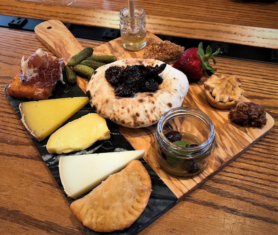 Photo -  The Local Cheese Board at The Jones Assembly includes up to five selections of Lovera's cheese from Krebs. [Dave Cathey/The Oklahoman]