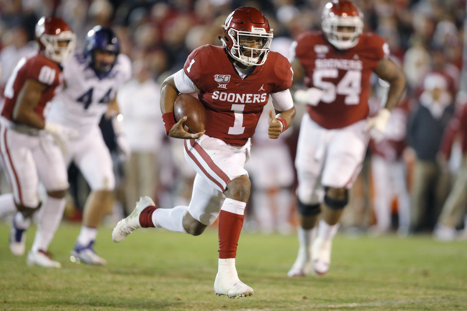Photo - Oklahoma's Jalen Hurts (1) carries the ball during an NCAA football game between the University of Oklahoma Sooners (OU) and the TCU Horned Frogs at Gaylord Family-Oklahoma Memorial Stadium in Norman, Okla., Saturday, Nov. 23, 2019. Oklahoma won 28-24. [Bryan Terry/The Oklahoman]