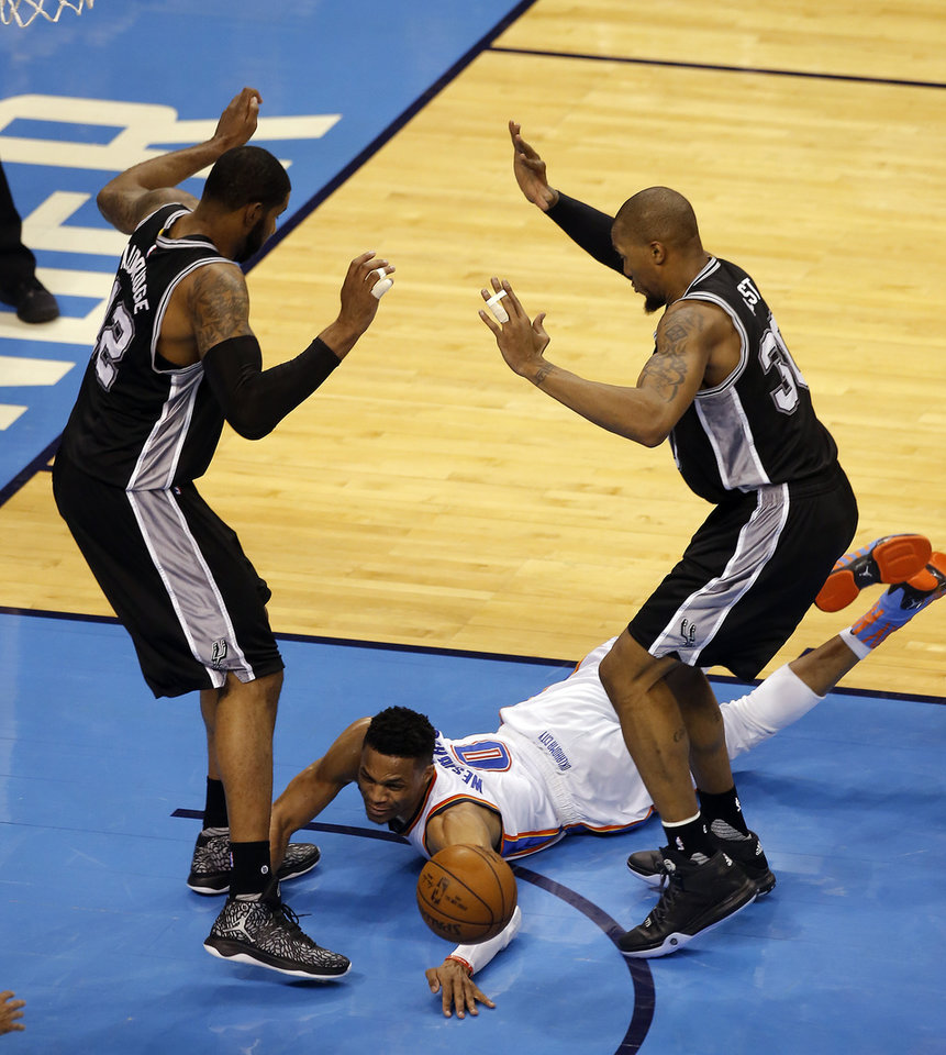 Photo - Oklahoma City's Russell Westbrook (0) looses the ball as San Antonio's LaMarcus Aldridge (12) and David West (30) defend during Game 4 of the Western Conference semifinals between the Oklahoma City Thunder and the San Antonio Spurs in the NBA playoffs at Chesapeake Energy Arena in Oklahoma City, Sunday, May 8, 2016. Photo by Sarah Phipps, The Oklahoman