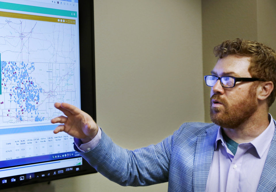 Photo -  Dan Yates, associate executive director of the Groundwater Protection Council, demonstrates software designed to help regulators quickly locate which disposal wells are near earthquake activity. Yates made the presentation at the Oklahoma Energy Resources Board. [PHOTO BY JIM BECKEL, THE OKLAHOMAN]