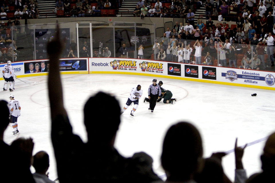 Photo - Fans cheer on the Barons during the AHL game between the Oklahoma City Barons and the Houston Aeros, Saturday, Oct. 9, 2010, at the Cox Convention Center in Oklahoma City. Photo by Sarah Phipps, The Oklahoman