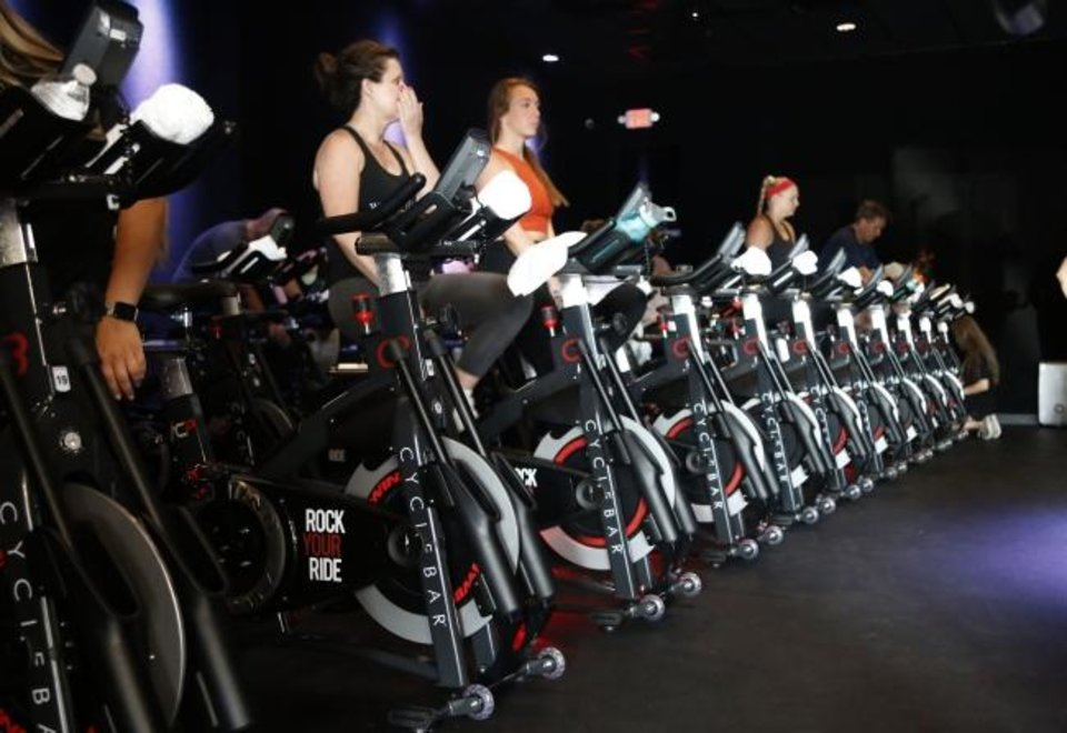 Photo -  Cyclists prepare for the 9:30 a.m. class to start at the new CycleBar studio in Norman on Thursday. [PAXSON HAWS/THE OKLAHOMAN]