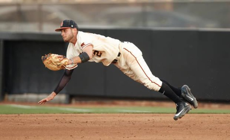Photo -  Oklahoma State's Andrew Rosa makes a catch for an out in the third inning of a Bedlam baseball game at Allie P. Reynolds Stadium in Stillwater, Okla., on Tuesday, March 21, 2017. [Photo by Bryan Terry, The Oklahoman]