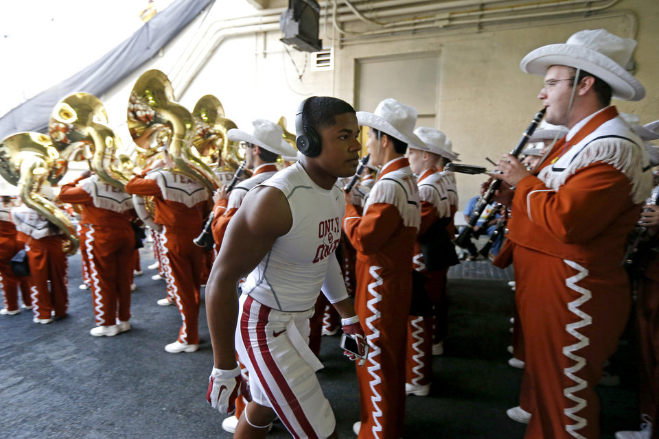 Photo - Sterling Shepard walks past the Texas band before the Red River Showdown college football game between the University of Oklahoma Sooners (OU) and the University of Texas Longhorns (UT) at the Cottonbowl in Dallas on Saturday, Oct. 11, 2014. 