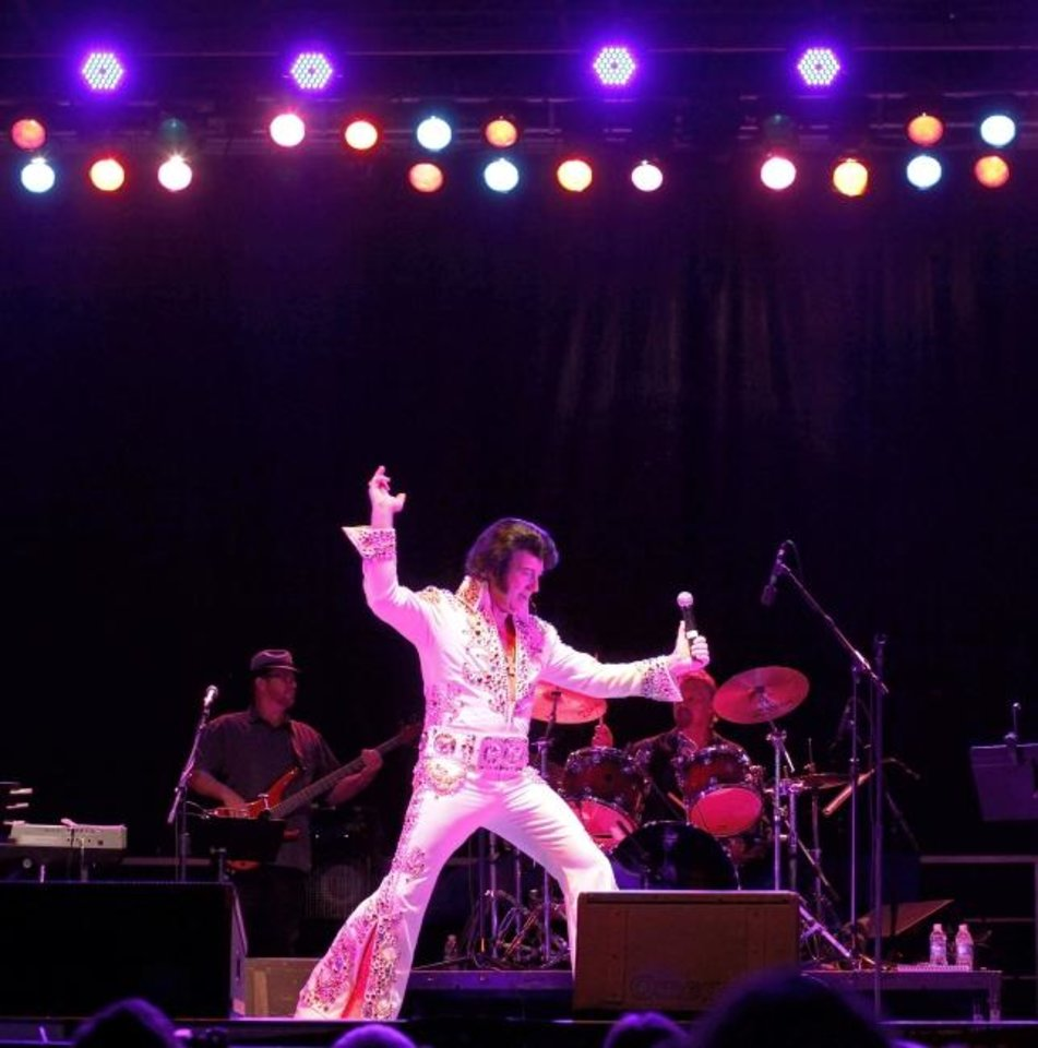Photo -  An Elvis impersonator performs at the Oklahoma State Fair. [The Oklahoman Archives]