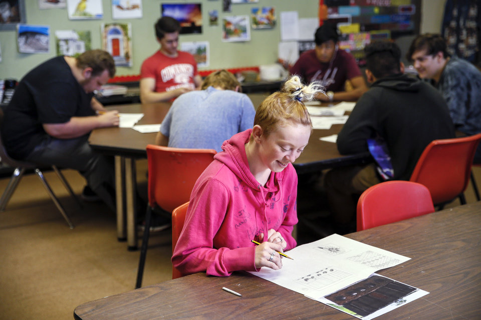 Photo - Beka Maddox, 18 of Duncan, works on a drawing in the art room at FAME Academy, an alternative school in Comanche Public Schools, in Meridian, Okla., Wednesday, Oct. 3, 2018. Photo by Nate Billings, The Oklahoman
