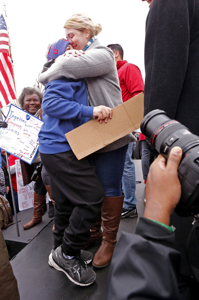 Photo - Kelly Lisenbee, Edmond, hugs her son Ben, 8, on stage after a desperate plea to the crowd to find him before the Oklahoma teachers rally at the State Capitol on Monday, April 2, 2018 in Oklahoma City, Okla.  Photo by Steve Sisney, The Oklahoman