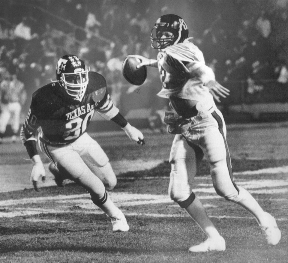 Photo - COWBOYS /  OKLAHOMA STATE UNIVERSITY, COLLEGE FOOTBALL, OSU: 12/12/1981-Rusty Hilger tries to pass before Texas A&M's Keith Baldwin makes a sack during the Independence Bowl. The Cowboys lost 16-33. Staff photo by David McDaniel