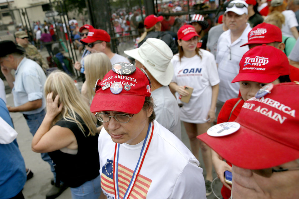 Photo - President Donald Trump supporters walk toward a security checkpoint before a rally at the BOK Center in Tulsa, Okla., Saturday, June 20, 2020. [Bryan Terry/The Oklahoman]