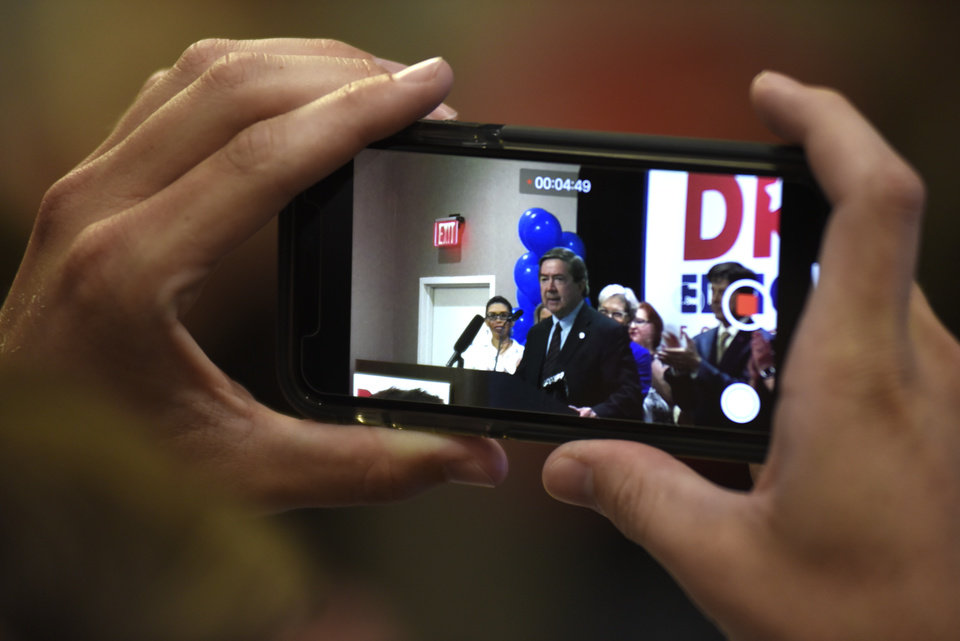 Photo - A supporter watches democratic candidate for governor, Drew Edmondson speak at his primary victory party in Oklahoma City on June 26, 2018. Nick Oxford for The Oklahoman