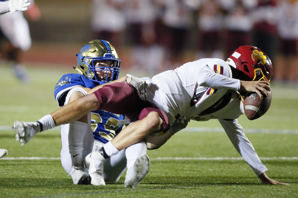 Photo - Choctaw's Donnie Wingate sacks Putnam City's Carson Laverty during a high school football game between Choctaw and Putnam City North at Choctaw, Okla., Friday, Nov. 20, 2020. [Bryan Terry/The Oklahoman]