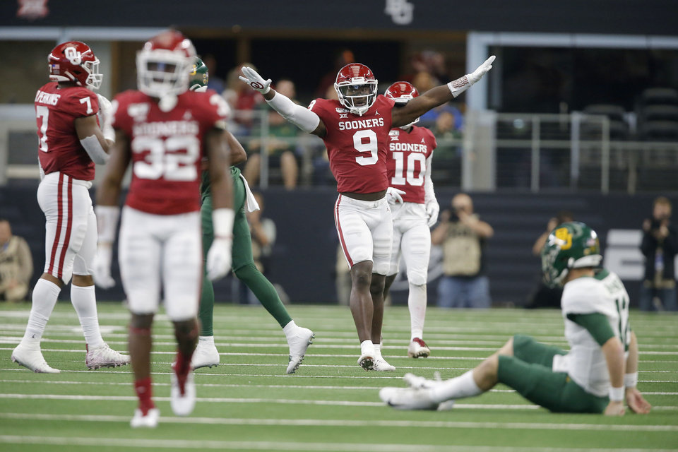 Photo - Oklahoma's Kenneth Murray (9) celebrates during the Big 12 Championship Game between the University of Oklahoma Sooners (OU) and the Baylor University Bears at AT&T Stadium in Arlington, Texas, Saturday, Dec. 7, 2019. Oklahoma won 30-23. [Bryan Terry/The Oklahoman]