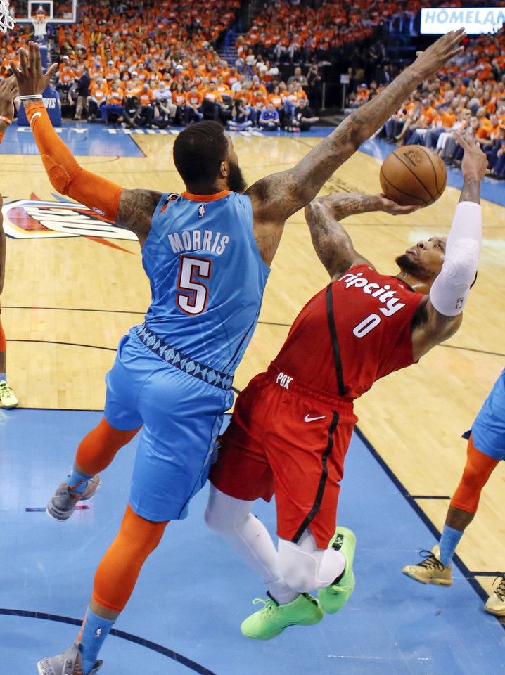 Photo - Oklahoma City's Markieff Morris (5) defends Portland's Damian Lillard (0) in the second half during Game 3 in the first round of the NBA playoffs between the Portland Trail Blazers and the Oklahoma City Thunder at Chesapeake Energy Arena in Oklahoma City, Friday, April 19, 2019. Oklahoma City won 120-108. Photo by Nate Billings, The Oklahoman