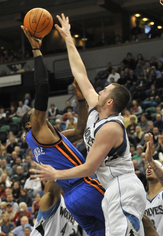 Photo -  Minnesota Timberwolves' Kevin Love, right, goes up to block a shot by New York Knicks' Amare Stoudemire in the second half of an NBA basketball game Friday, Nov. 12, 2010, in Minneapolis. Love led the Timberwolves with 31 points and 31 rebounds in the Timberwolves' 112-103 win. (AP Photo/Jim Mone) ORG XMIT: MNJM106