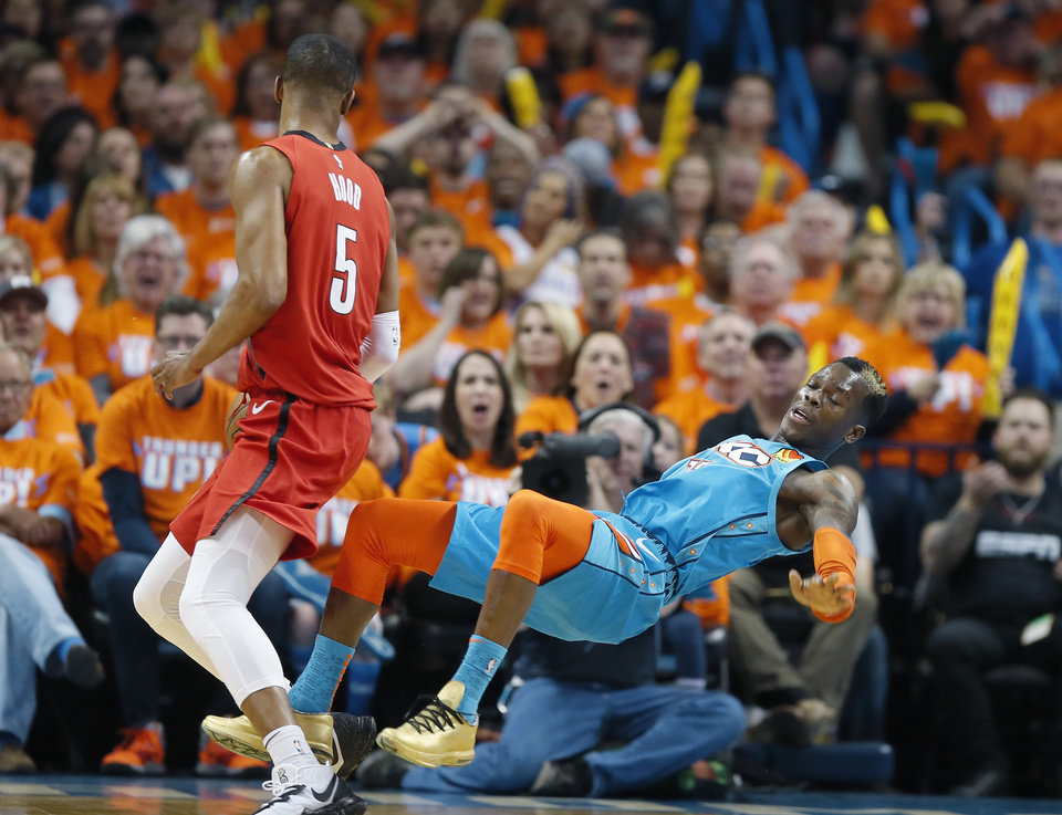 Photo - Portland's Rodney Hood (5) is called for a charge against Oklahoma City's Dennis Schroder (17) during Game 3 in the first round of the NBA playoffs between the Portland Trail Blazers and the Oklahoma City Thunder at Chesapeake Energy Arena in Oklahoma City, Friday, April 19, 2019. Photo by Bryan Terry, The Oklahoman