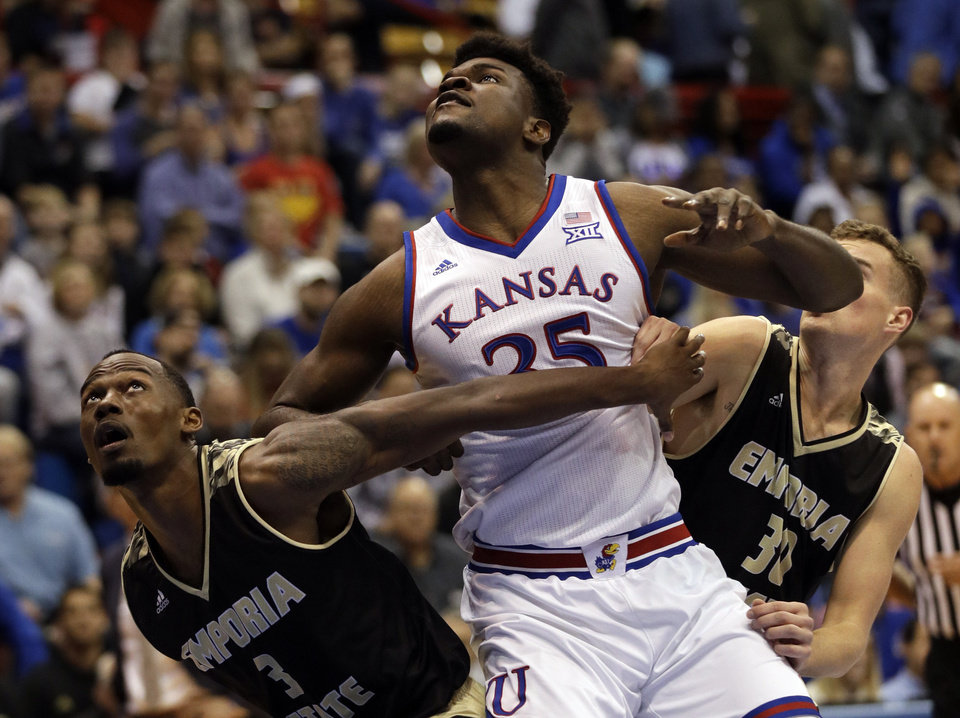 b22bb58a10917f Kansas center Udoka Azubuike (35) looks over Emporia State forward Hassan  Thomas (3) and guard Sawyer Glick (30) during the first half of an  exhibition NCAA ...