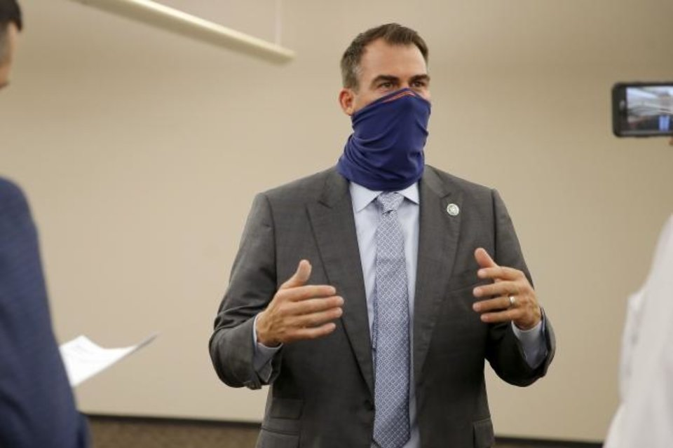 Photo -  Gov. Kevin Stitt speaks after a tour of a new Oklahoma State Department of Health COVID-19 contact tracing center inside the old Shepherd Mall in Oklahoma City on  Wednesday.  [Bryan Terry/The Oklahoman]