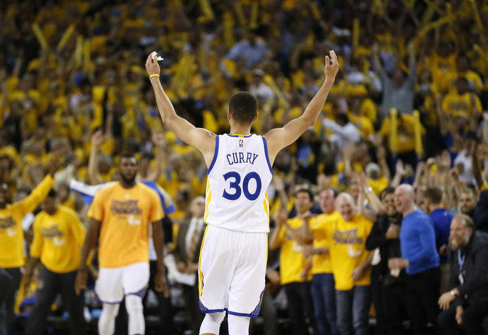 Photo - Golden State's Stephen Curry (30) reacts after hitting a three-point shot in the third quarter during Game 2 of the Western Conference finals in the NBA playoffs between the Oklahoma City Thunder and the Golden State Warriors at Oracle Arena in Oakland, Calif., Wednesday, May 18, 2016. Golden State won 118-91. Photo by Nate Billings, The Oklahoman