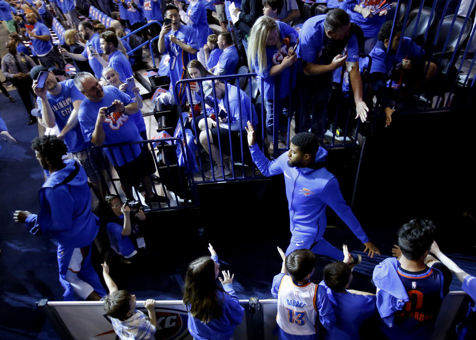 Photo - Oklahoma City's Paul George (13) walks onto the court during Game 4 in the first round of the NBA playoffs between the Portland Trail Blazers and the Oklahoma City Thunder at Chesapeake Energy Arena in Oklahoma City, Sunday, April 21, 2019. Portland won 111-98. Photo by Sarah Phipps, The Oklahoman