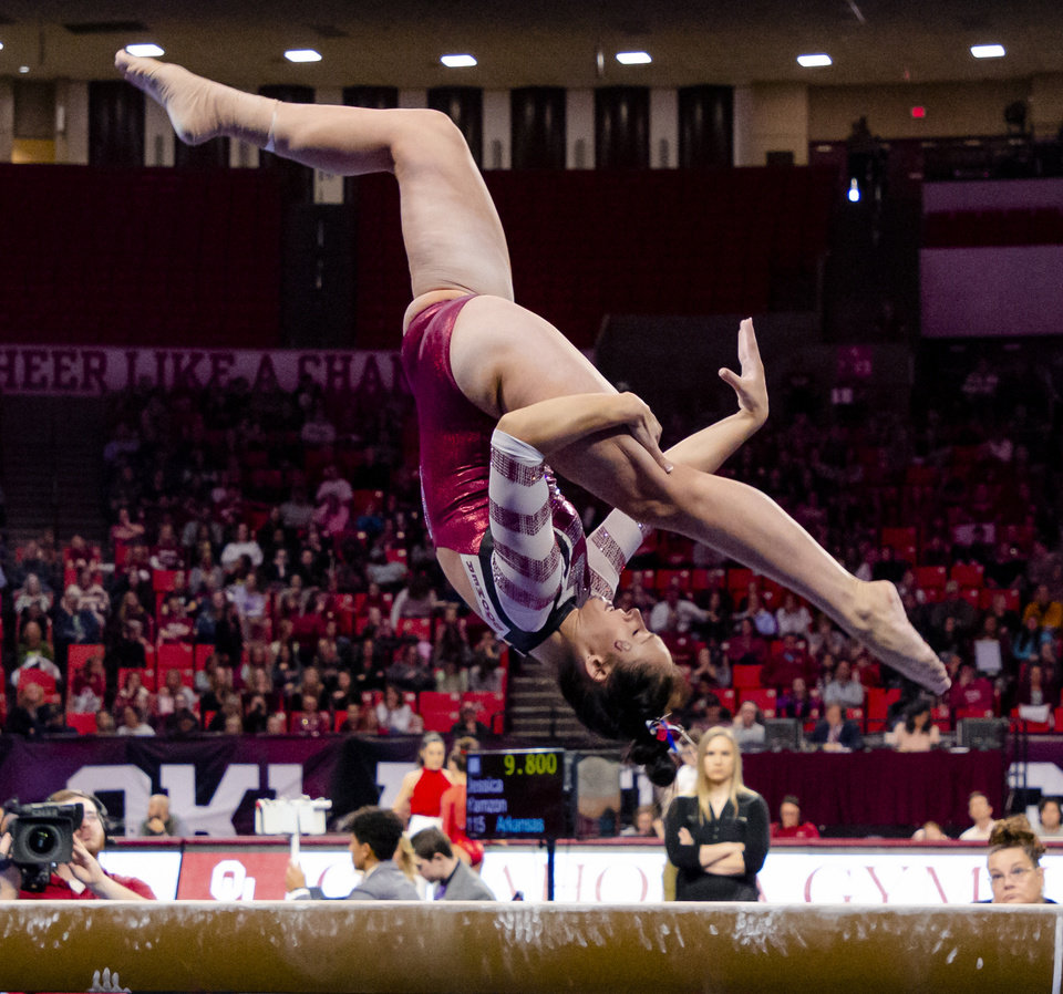 Photo - University of Oklahoma's Carly Woodard competes in the beam during the women's gymnastics competition between the University of Oklahoma and Arkansas at the Lloyd Noble Center in Norman, Okla Monday, Jan. 20, 2020.   [Chris Landsberger/The Oklahoman]