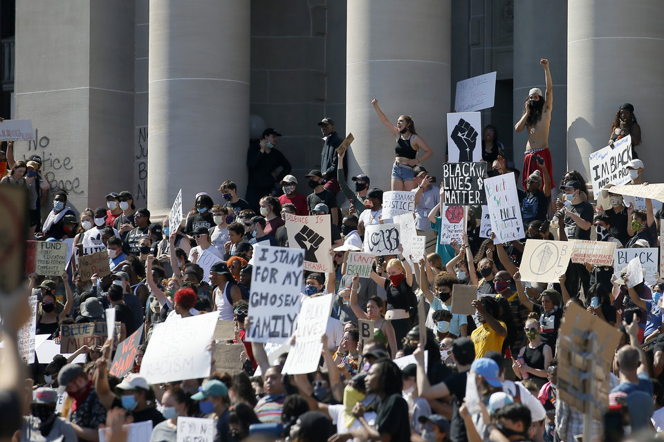Photo - Protesters stand on the south steps of the state Capitol in Oklahoma City on Sunday, May 31, 2020. The Black Lives Matter protest was in response to the death of George Floyd. [Bryan Terry/The Oklahoman]